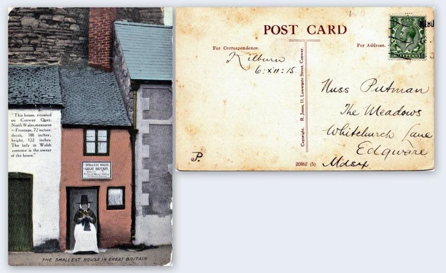kartka pocztowa z domem i kobietą