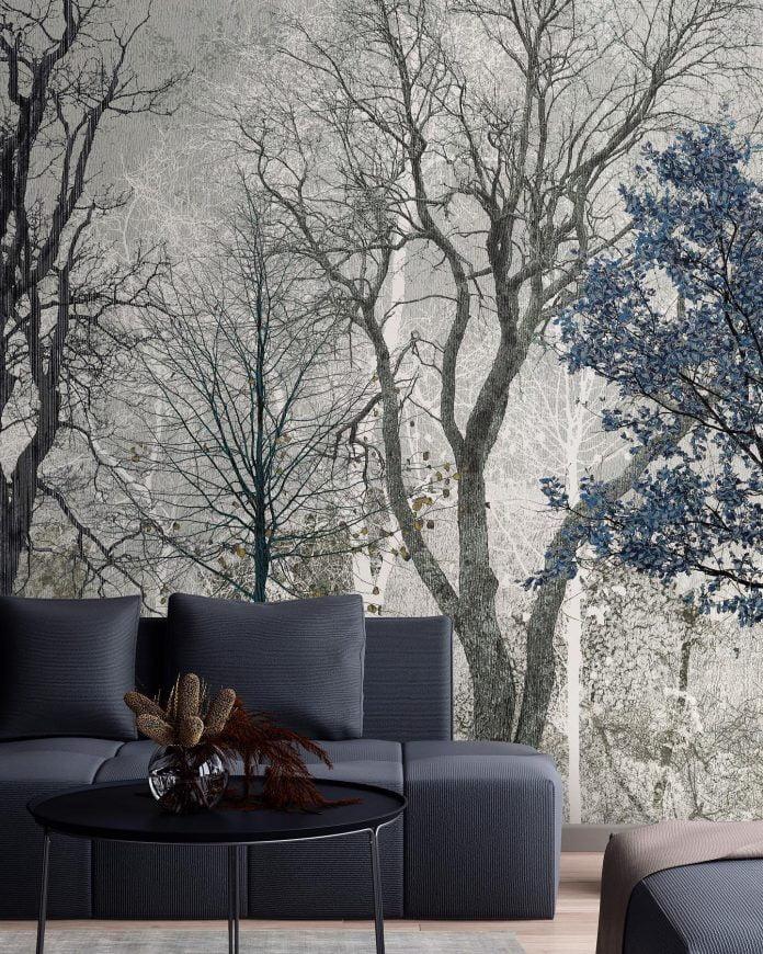 Fototapeta drzewa na ścianie i kanapa